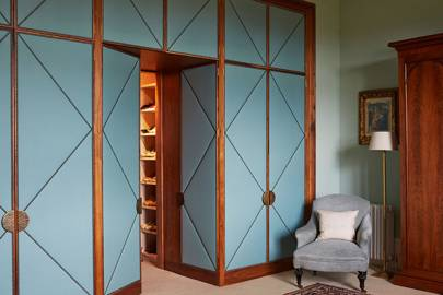 Studded blue leather fitted wardrobes