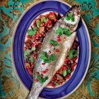 Baked sea bass with aubergine, walnuts and pomegranates