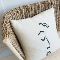 8. Small Face Print Woollen Cushion