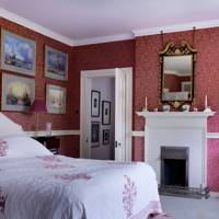 Neutral Headboard in a Pink Room