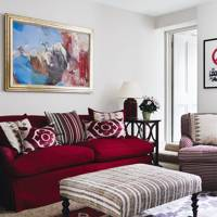 White Living Room with Red Sofa