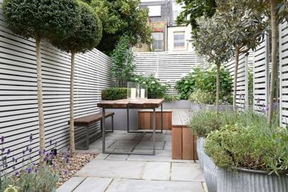 Small Patio Garden with Wooden Bench