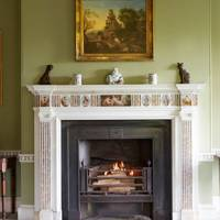 Traditional fireplace with marble chimneypiece