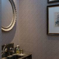 Small cloakroom with patterned wallpaper