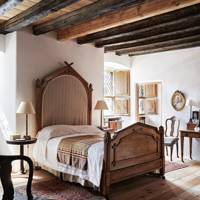 Wooden Headboard Bed with beamed ceiling