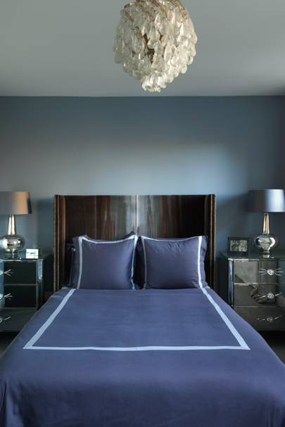 Small blue bedroom with curved headboard