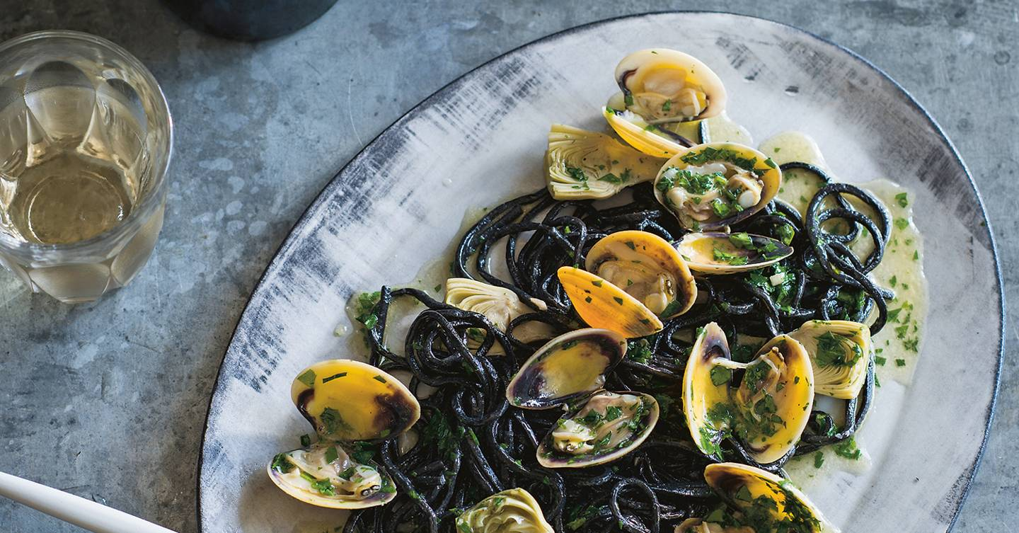 Squid ink pasta with artichokes and clams