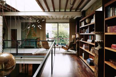 Wooden bookshelves on mezzanine