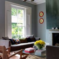 Living room with grey walls and yellow accents