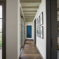 White Hallway with Blue Artwork