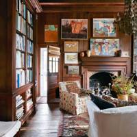 Panelled living room with armchairs and bookcase