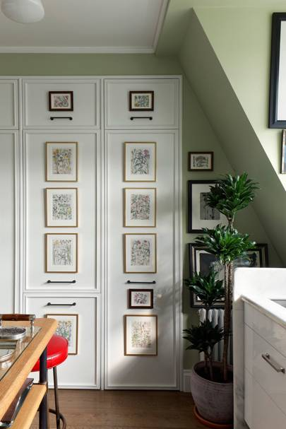 Botanical Prints Hung Vertically on Kitchen Cupboards